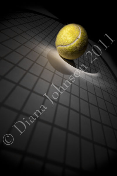 Tennis ball and racquet shadow